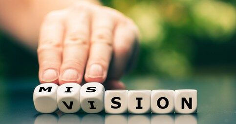 vision-mission-hand-turns-dice-260nw-1777337453